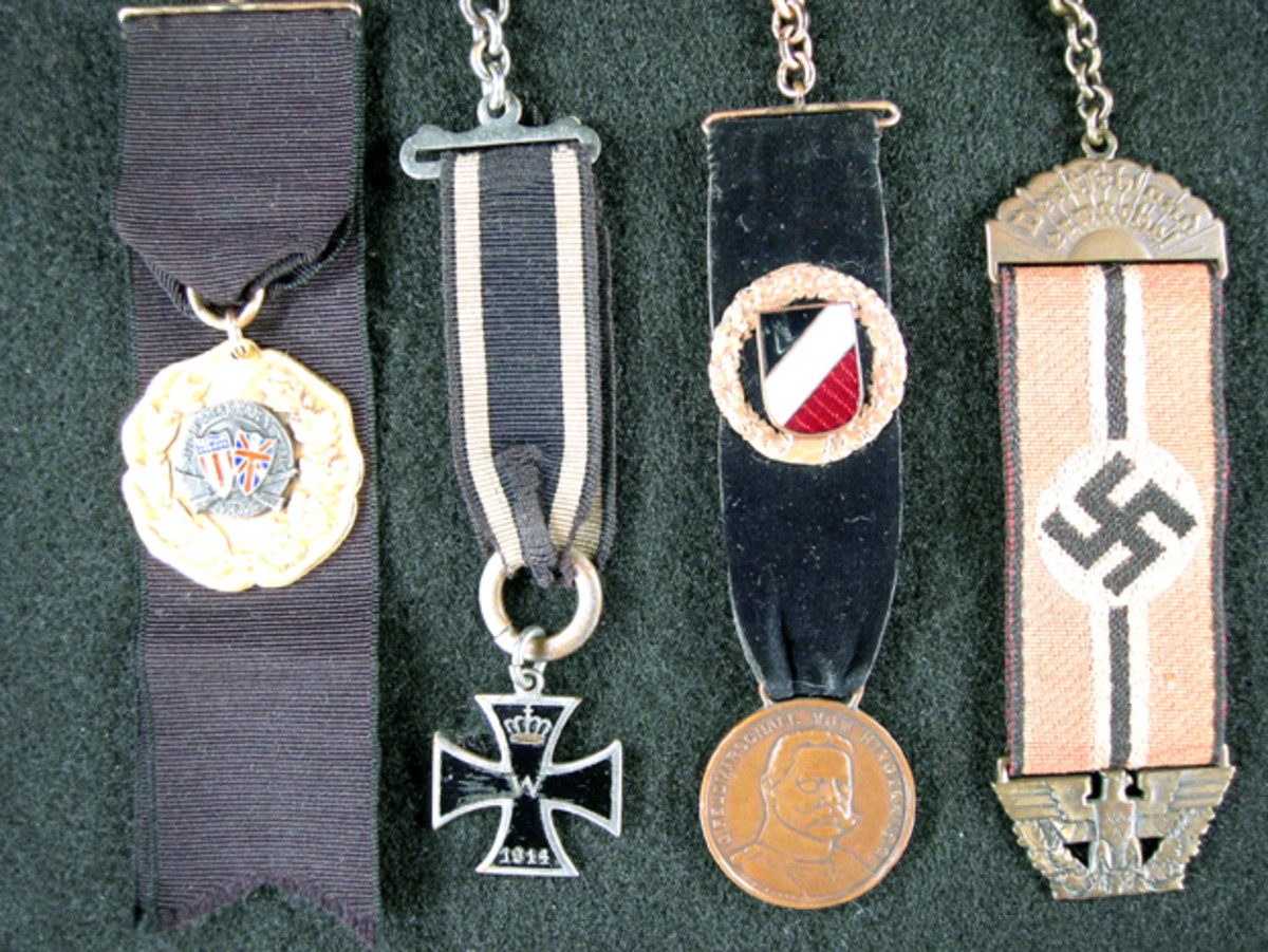 These attractive fob suspensions add to the historic background of the fobs (left to right): British Great War Veteran 1914-1919; German WWI Iron Cross; Field Marshal Hindenburg Patriotic fob 1914; National Socialist German Workers' Party.