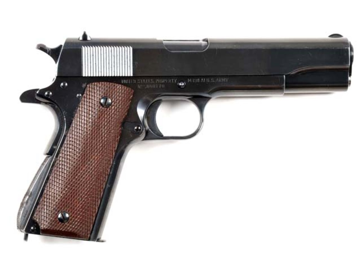 Singer Mfg Model 1911 A1 semi-automatic pistol, one of the great rarities in the Colt collecting field, estimate $80,000-$120,000. Morphy Auctions image