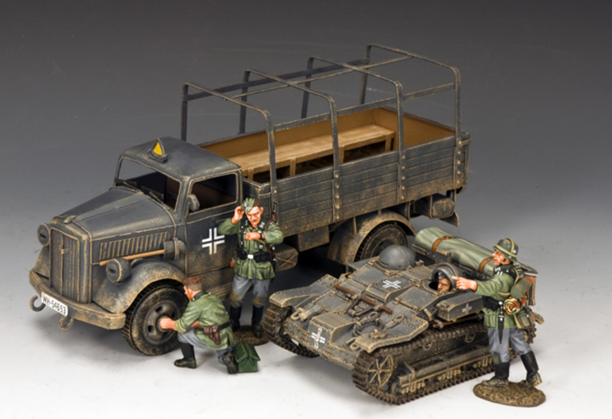 """These classic Wehrmacht troopers are behind schedule due to some """"unscheduled maintenance"""" on their tinplate Opel 'BLITZ'."""