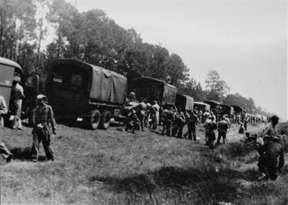 Army Air Corps 3rd Attack Group convoy on 1941 Maneuvers stop while the mess unit serves up the meal.