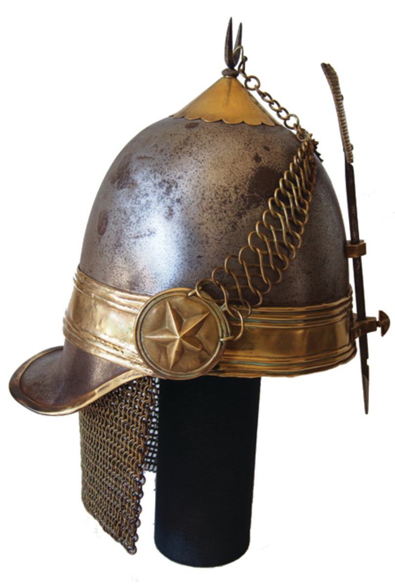 The helmet features numerous Islamic symbolisms including the crescent at the dome, and the five pointed star – denoting the Five Pillars of Islam. (Collection of the author)
