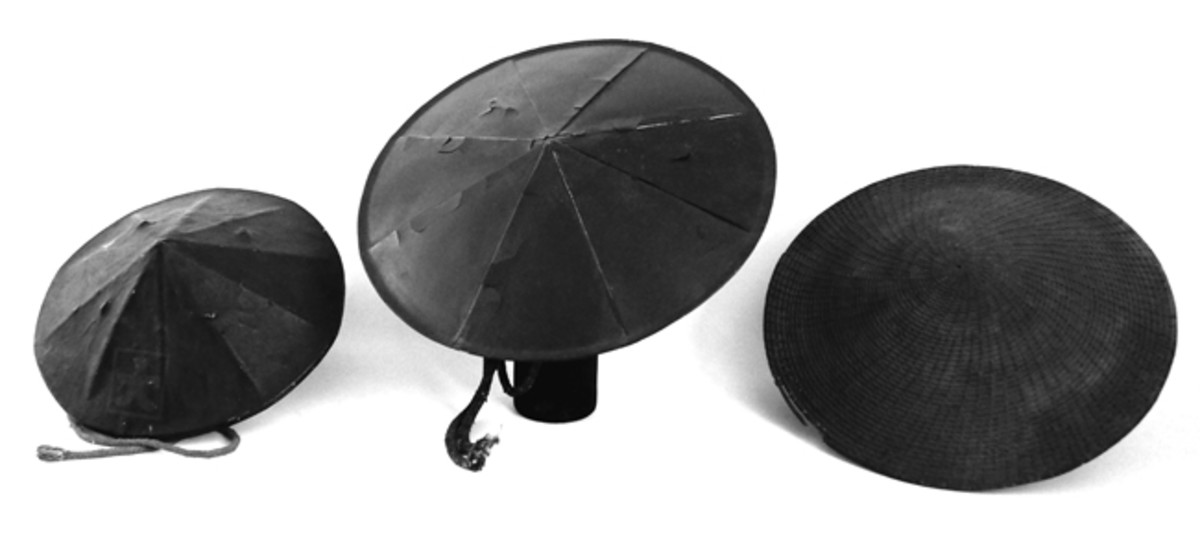 A trio of Japanese jingasa hats from the 19th century. The one on the far left is of the style utilized by the ashigaru (infantrymen), the center one is of the style used by the Aizu rifle corps, while the one on the right is a daily wear hat/peacetime headdress favored by the samurai. It features a complex weave pattern that may have denoted one's status.