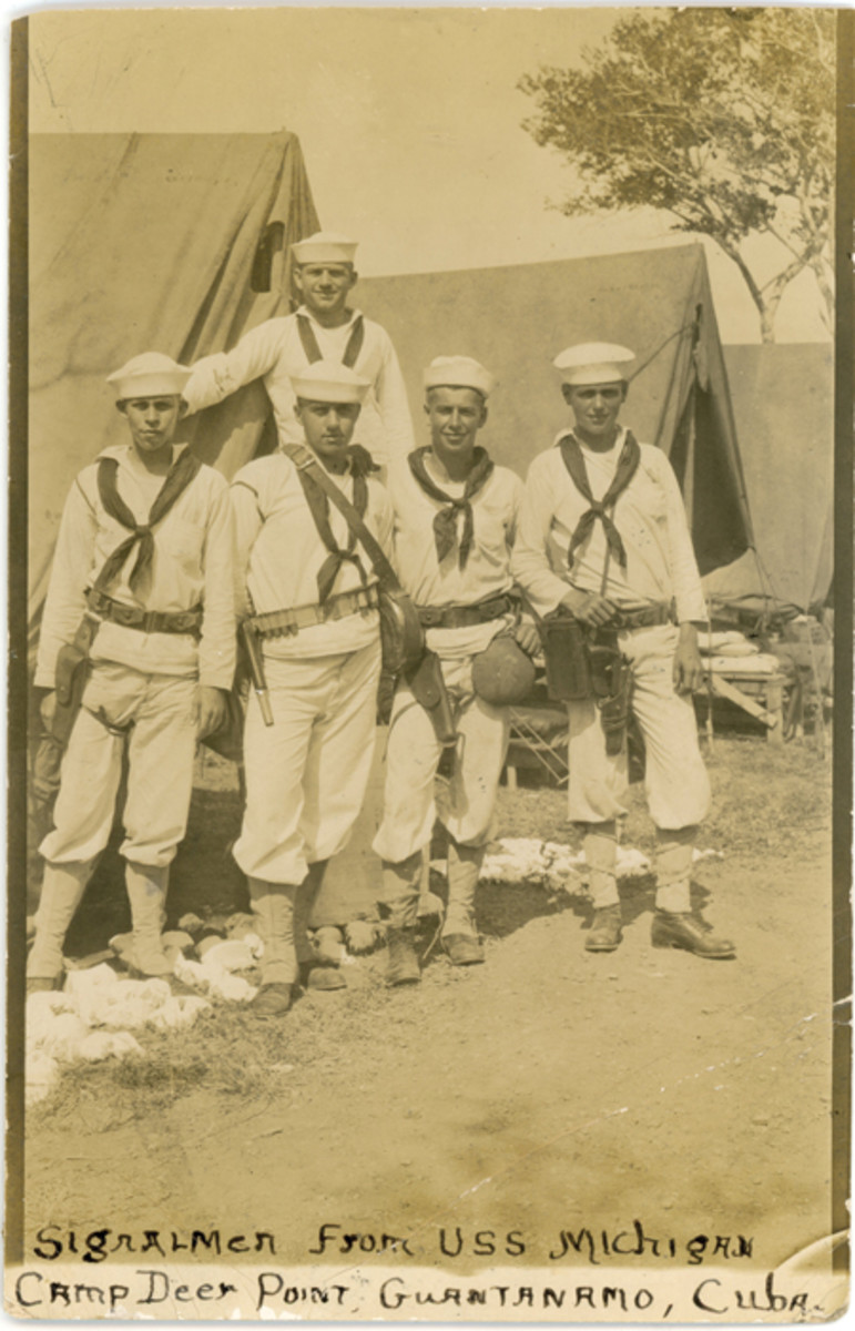 Two of the sailors from the USS Michigan are seen with holstered Mk III Very pistols in this ca. 1915 photo taken in Guantanamo, Cuba. John Adams-Graf Collection