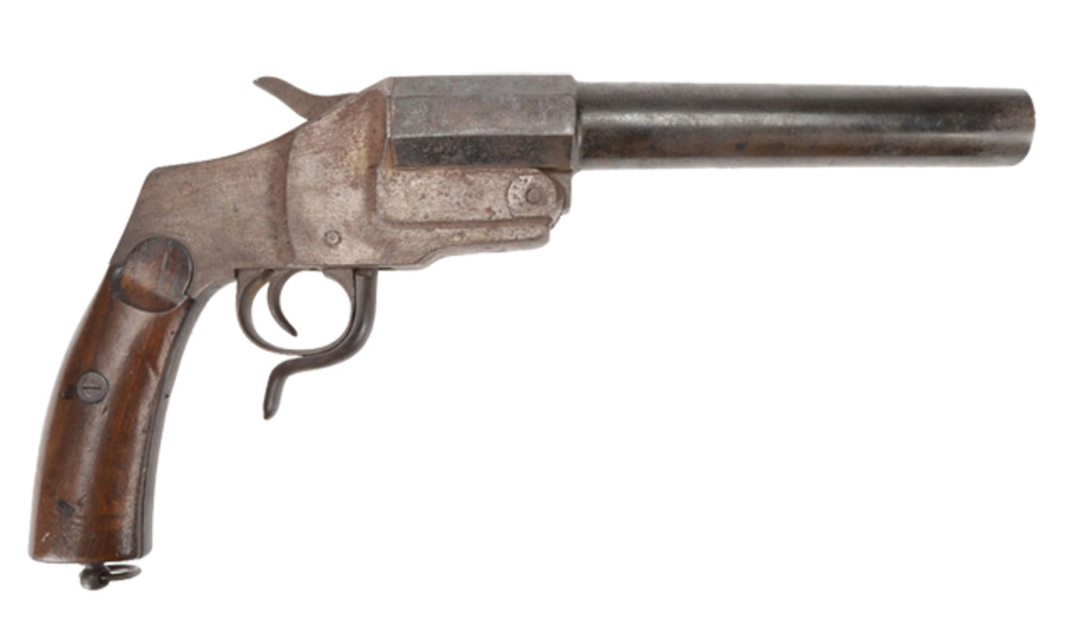 The Hebel Pattern flare pistol has the breech break lever mounted below trigger guard, two-piece walnut grips, and lanyard loop.Advance Guard Militaria