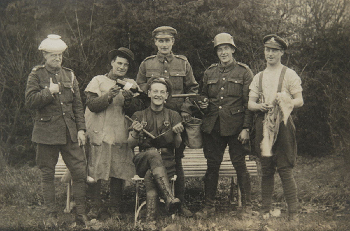 A group of British soldiers clown for the camera, ca. 1916. The soldier wearing a captured German helmet is also holding an Austrian Hebel Pattern flare pistol. Flare guns were valuable to both sides during WWI, being used by aviators, ground troops, and naval forces to illuminate, communicate, and signal — roles that signal guns fulfill to this day. John Adams-Graf Collection