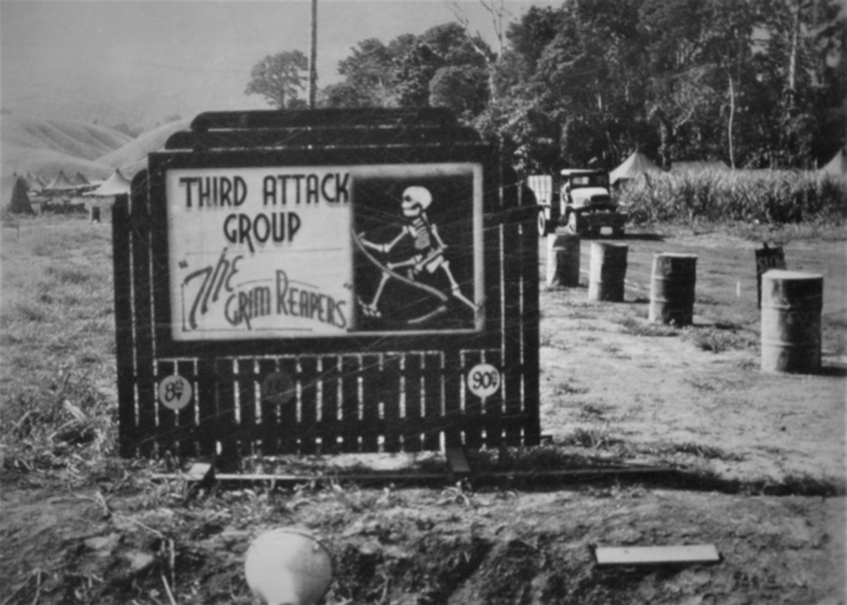 The Grim Reapers, Third Attack Group, 5th Air Force, Southwest Pacific area, field headquarters at Port Moresby, New Guinea, about 1943. Note the tentage and the cargo truck in the background.