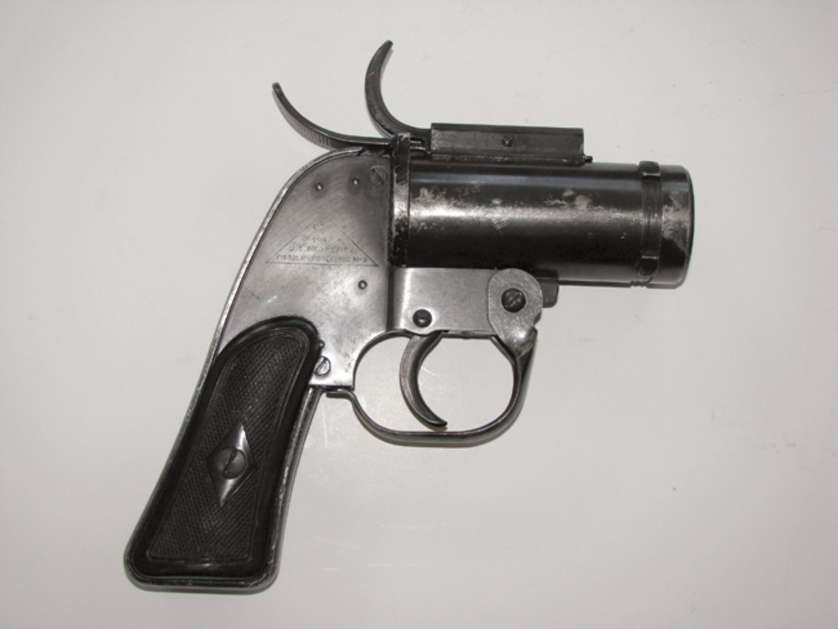 Produced in 1942, this U.S. M-8 flare pistol shows the locking lugs used to secure it in an aircraft fuselage port.