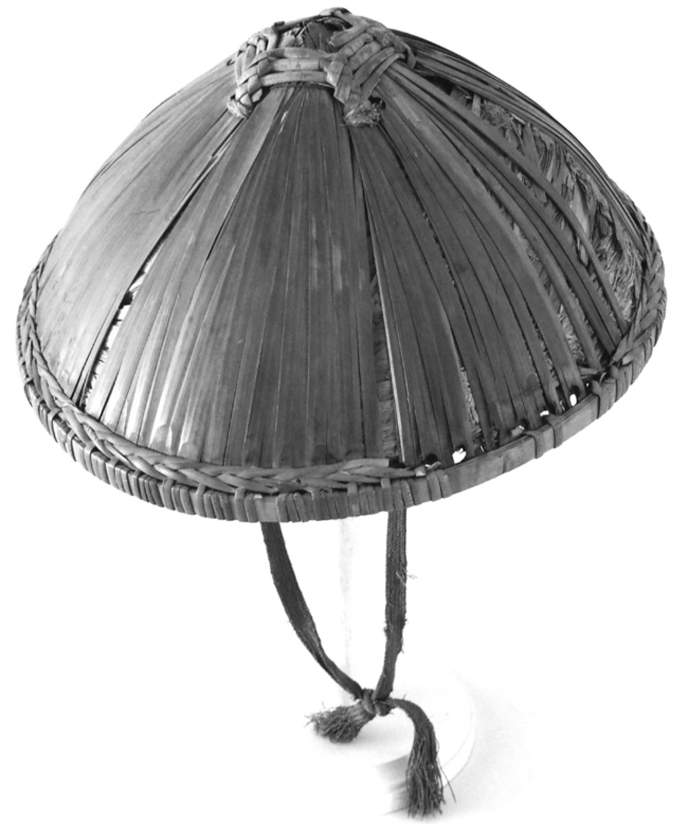 The traditional Doˇulì conical hat of China. This example dates to the era of the Boxer Rebellion.