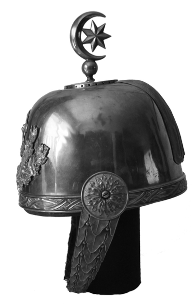 A side view of the helmet shows the crescent and a seven pointed star. It should be noted that the crescent and star also had been used by the Sassanian rulers of ancient Persia, and it is believed that this is where the early Muslim converts first adopted this symbol. (Collection of the author)