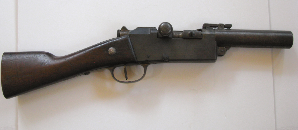 Necessity is the mother of invention. This French piece started life as a Lebel M1886 infantry rifle before being converted to a single shot flare gun.