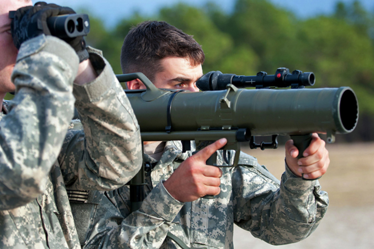 A paratrooper with the 82nd Airborne Division's 1st Brigade Combat Team shoulders a Carl Gustav M3 84mm recoilless rifle while his partner optically measures the distance to a target during a certification class Dec. 6, 2011, at Fort Bragg, N.C. The paratroopers are preparing for a deployment to Afghanistan. (U.S. Army photo by Sgt. Michael J. MacLeod)