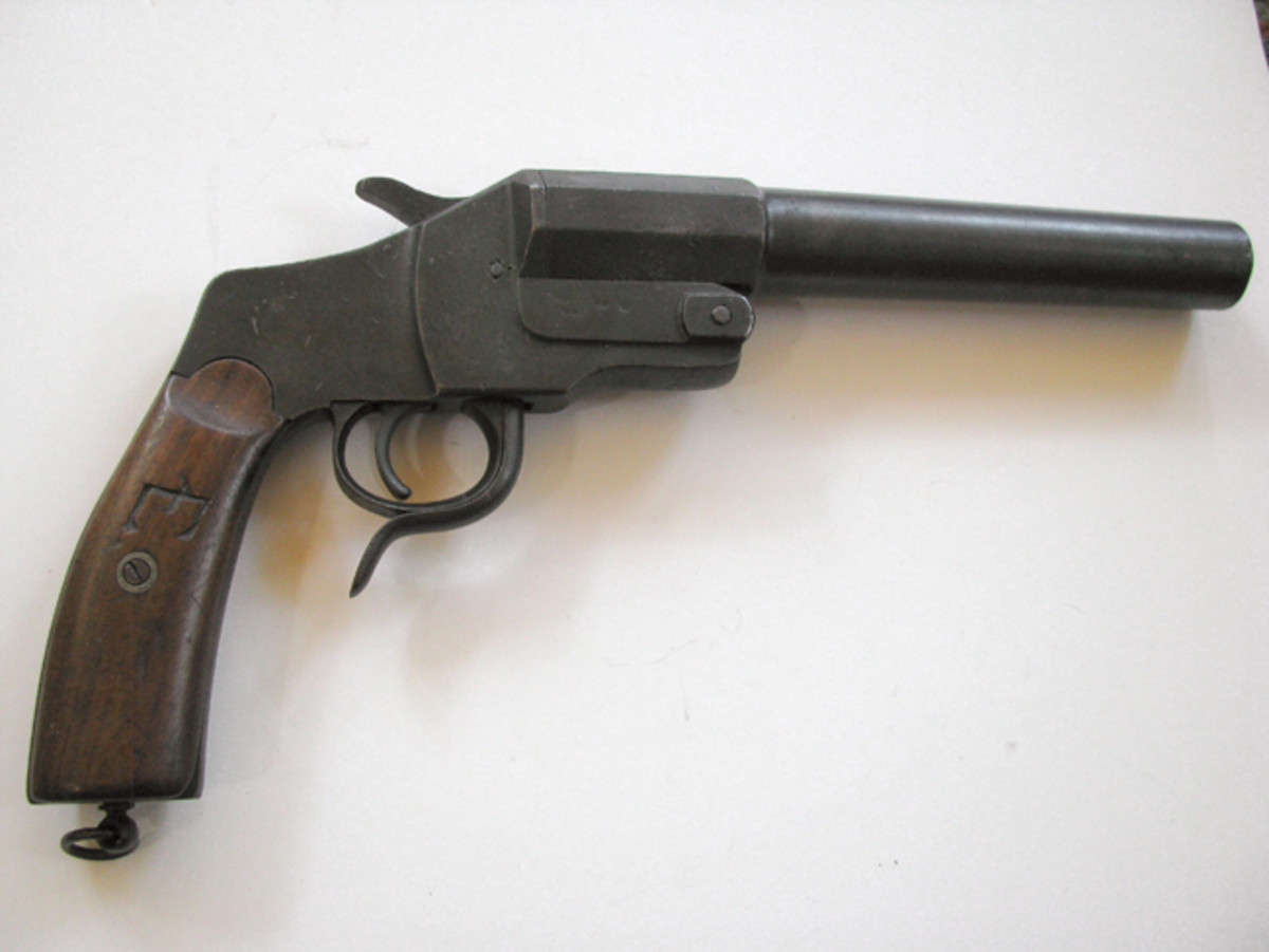 This long WWI-vintage German flare pistol was personalized with a soldier's initials carved into the grip panels.