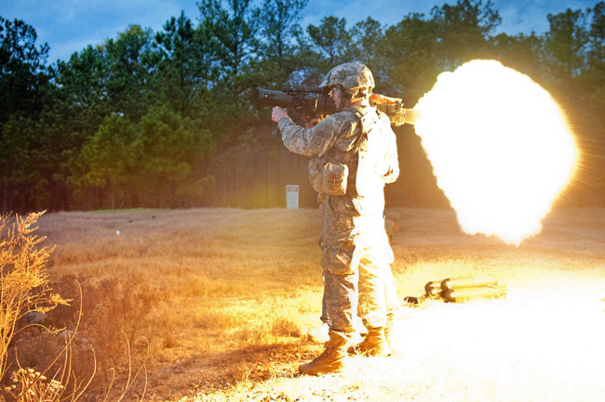 Two paratroopers with the 82nd Airborne Division's 1st Brigade Combat Team fire a round from a Carl Gustav M3 84mm recoilless rifle during a certification class Dec. 6, 2011, at Fort Bragg, N.C. Care must be taken to clear the backblast area prior to the weapon's operation. (U.S. Army photo by Sgt. Michael J. MacLeod)