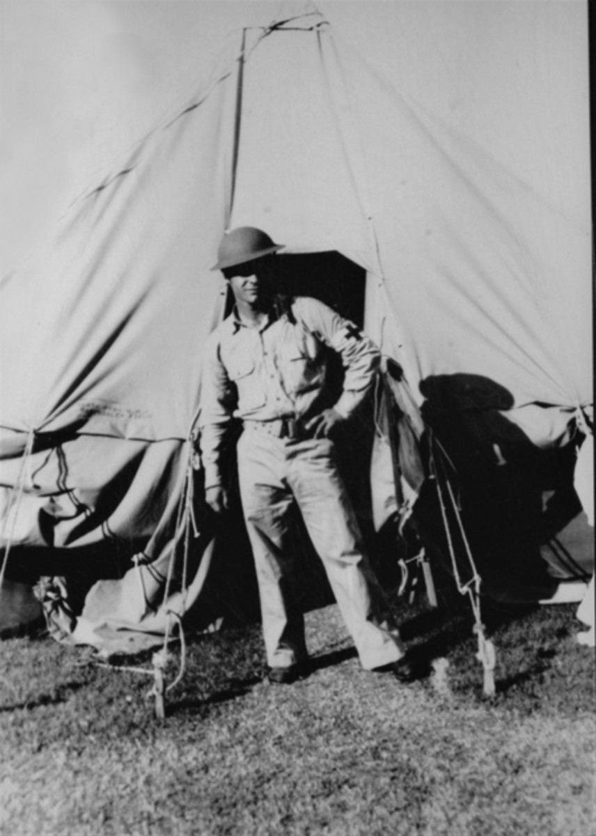 A well turned out Army Air Corps medic: Louis Sigrist stands in front of his pyramid tent during the Summer 1941 Maneuvers.