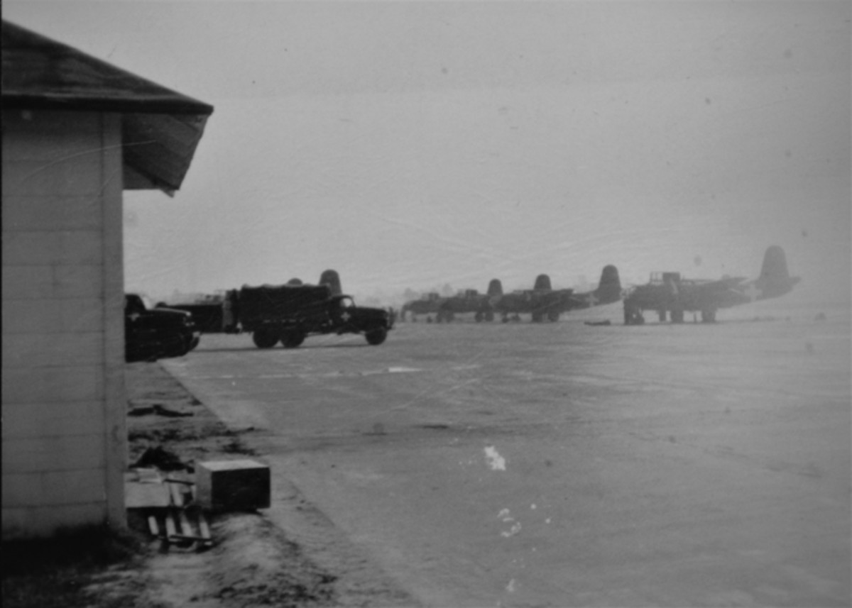 A-20 attack aircraft on the flight line near the ready room. 1941 Maneuvers.