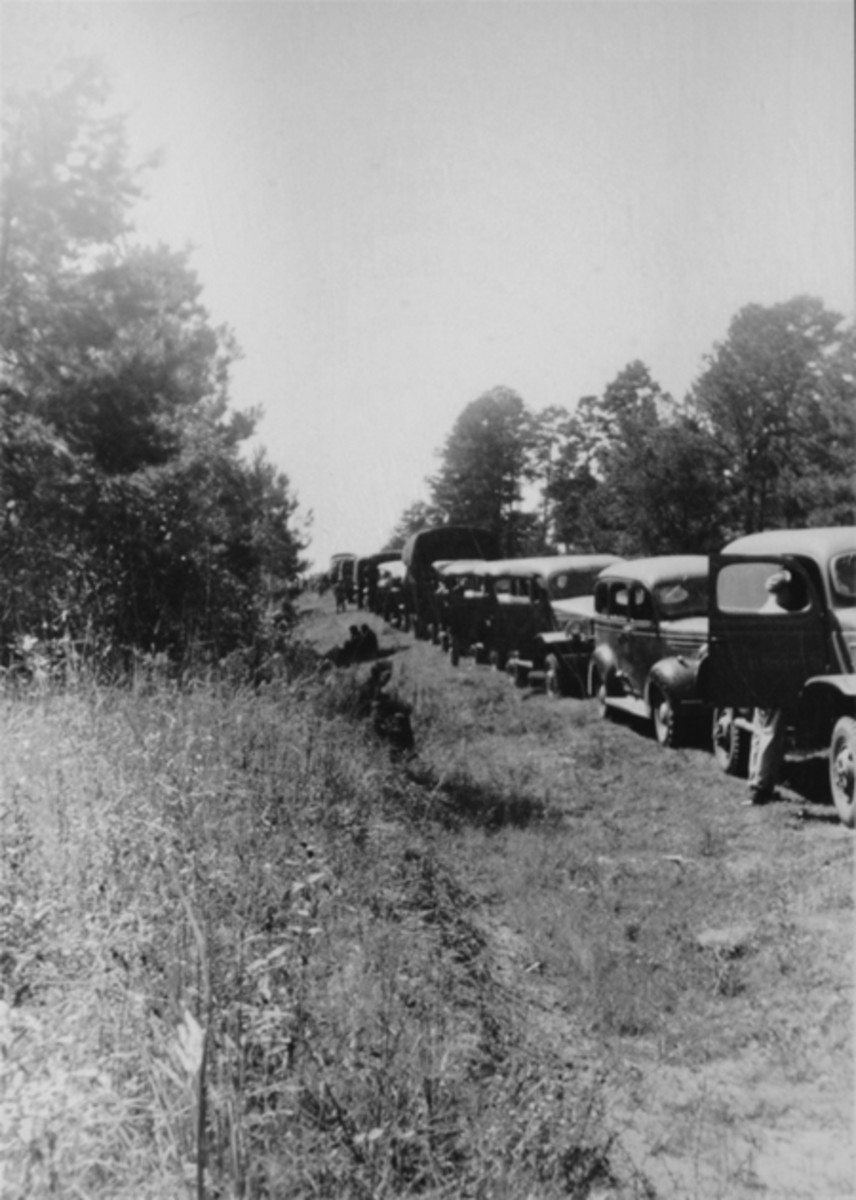 Convoy from Savannah, Georgia, to Barksdale Field, Louisiana, on a march rest during the 1941 Maneuvers. Dodge WC and VC vehicles can be seen.