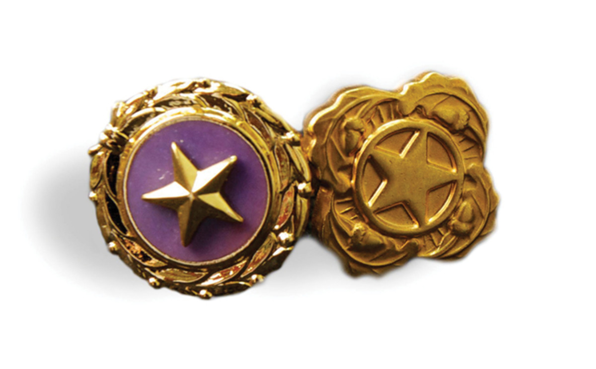 "Gold Star Lapel Button (left) are presented to and worn by surviving spouses, parents, and immediate family members of Armed Forces members killed in combat operations. On the reverse is the inscription ""United States of America, Act of Congress, August 1966"" with space for engraving the initials of the recipient. Next of Kin Lapel Buttons (right) are presented to and worn by immediate Family members of United States Armed Forces members who die while serving outside of combat operations."