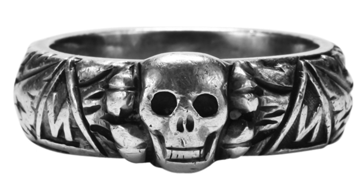 An official jewelry item was the SS ring which featured a Totenkopf and runic symbols around the exterior.