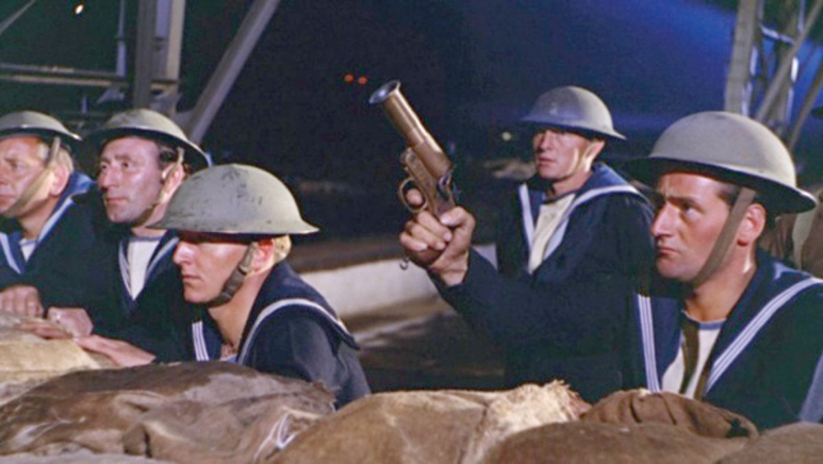 """Sailors in the 1961 British science fiction movie, """"Gorgo,"""" standby with a Webley & Scott Mark III Very Light Signal Flare Pistol to signal the approach of the monster."""