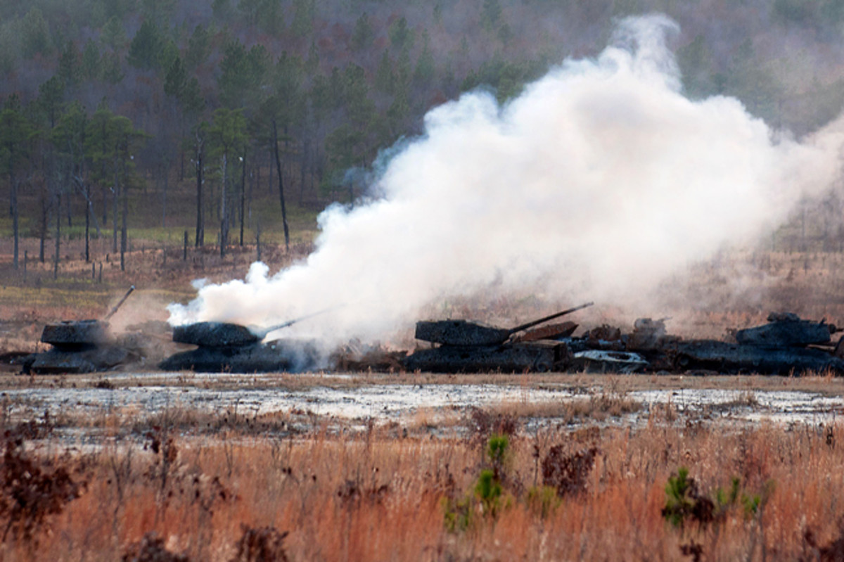Projectiles from a Carl Gustav M3 84mm recoilless rifle impact old tanks during a weapons certification course for paratroopers with the 82nd Airborne Division's 1st Brigade Combat Team Dec. 6, 2011, at Fort Bragg, N.C. The multi-role weapon can be used against armor, fortifications and personnel. (U.S. Army photo by Sgt. Michael J. MacLeod)