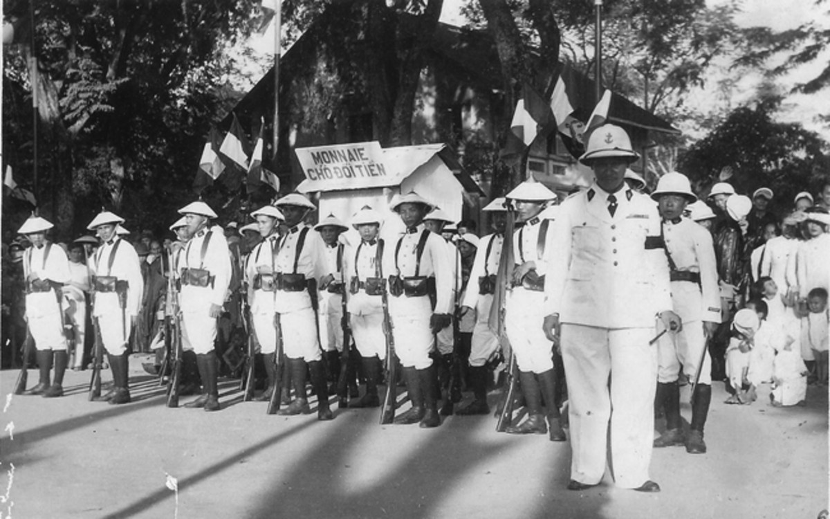 Tirailleurs Indochinois in French Indo-China circa 1935. Note the French officer and the Asian NCO are wearing Model 1931 sun helmets. The rest of the soldiers are wearing the nón lá / salacco conical hat.