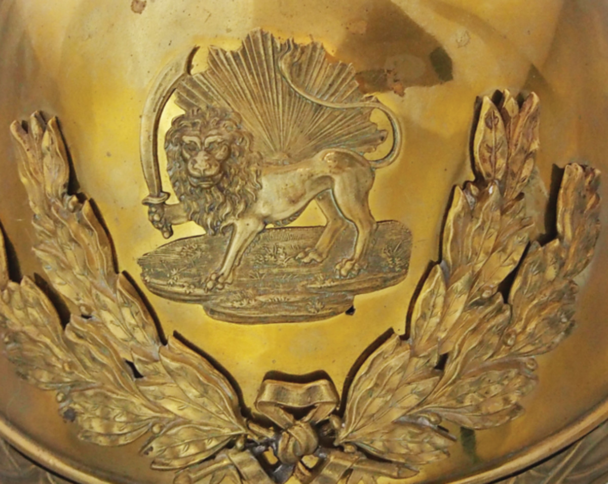 A close up of the Qajar helmet plate – it features the lion and sun that stands for the two pillars of society – the state and the Islamic religion. (Collection of the author)