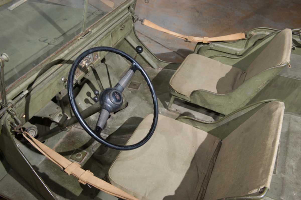 •The interior of the 1940 Ford Pilot Model GP-No. 1 Pygmy is sparse and utilitarian. Like much of GP-No .1, is almost entirely unrestored. The steering wheel differs from the three-spoke unit GP-No. 1 was originally equipped with, as it broke during military testing. The current two-spoke steering wheel was fitted for the remaining testing in 1940.