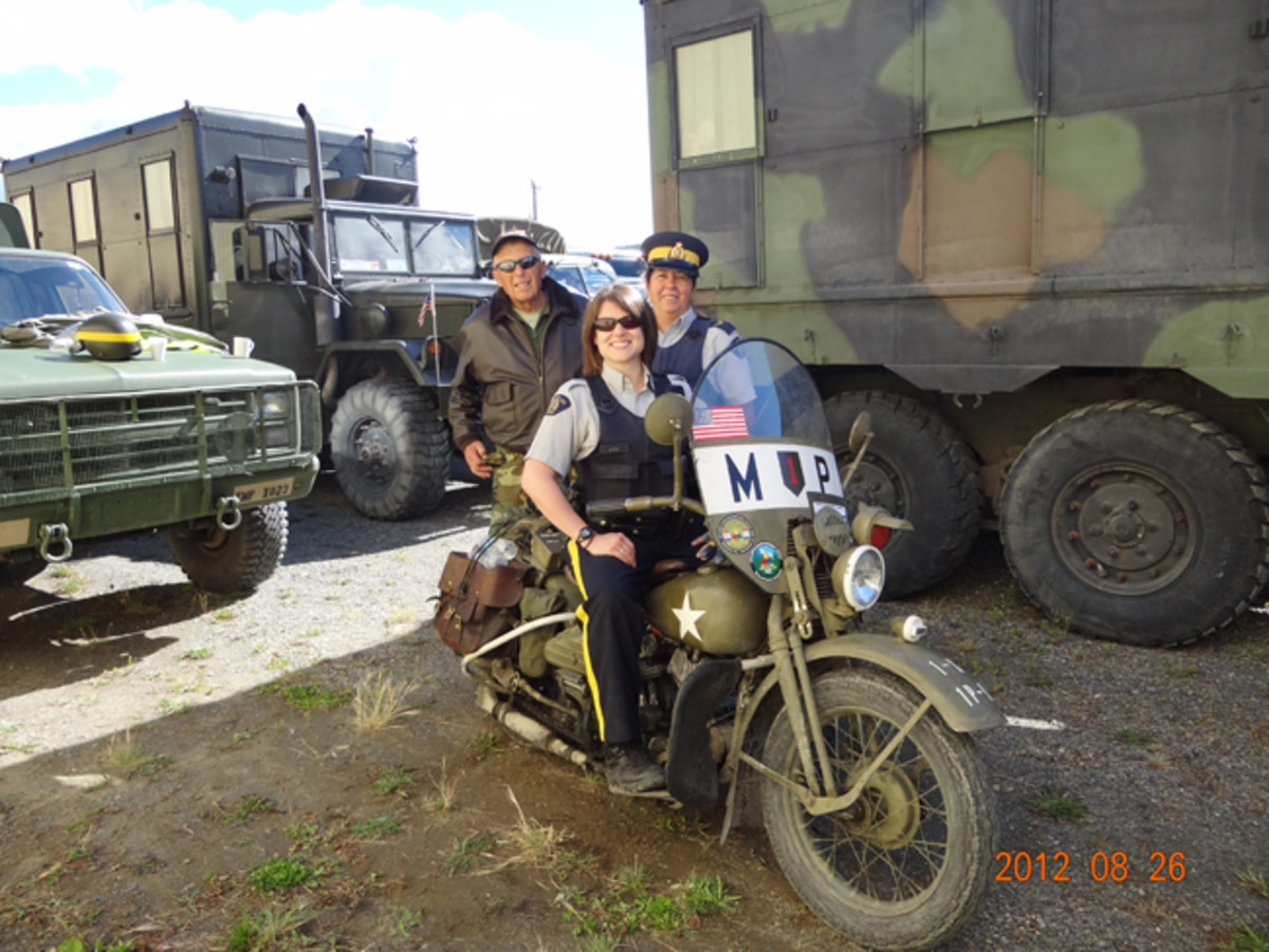 WWII MP veteran and retired Nevada Motor Patrol Officer Bill Kreider and his WLA with a couple of admiring police officers in 2012 on the Alaska Highway Convoy. Bill draws people on all the convoys wherever he goes. Willy Delmeier