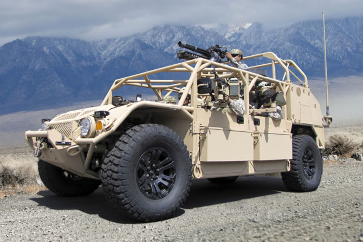 U.S. military off-road vehicle. A GMV 1.1 .with a minigun mounted at the gunner's station. The gunner's mount can transverse a full 360 degrees for all round defense. Note the storage boxes fitted to the doors. Also visibile on the front of a vehicle is a winch for recovery purposes. U.S. DoD Photo.