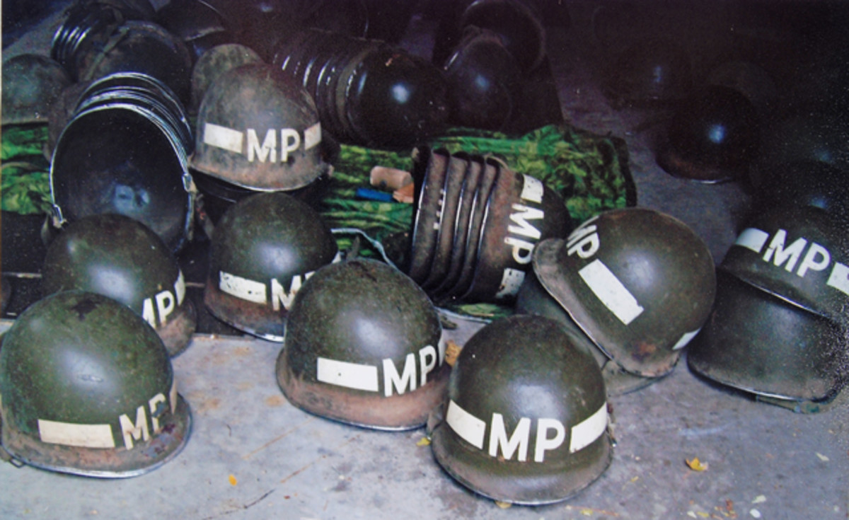 "Farm-fresh MP helmets after just 63 years in storage! As luck would have it, the exposed 2"" of the helmet rim was the only surface rust, dirt, or dust. A damp cloth cleaned off 90% of it."