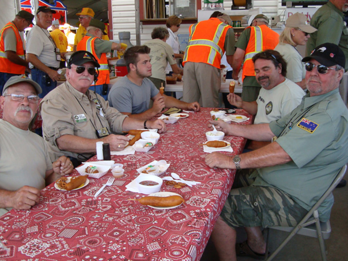 Food on the convoy is always great and many times provided by service organizations at the convoy stops. Tom Sears, Ray Barth, Aaron ,and Jim Diamond, and Pete Yates enjoy lunch at the Texas State Fair. You can gain weight on convoys! Willy Delmeier