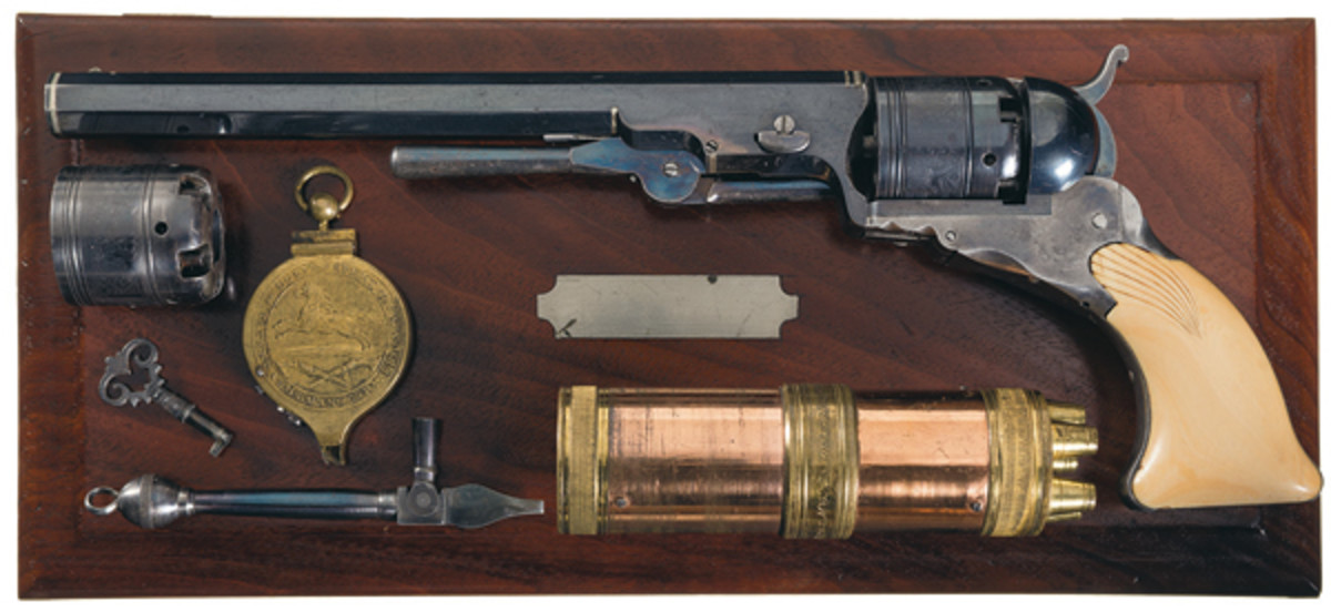 """Profoundly Rare and Equally Magnificent Cased Colt No. 5 Texas Paterson with 6 Silver Bands 9"""" Barrel, Loading Lever and Shell Carved Ivory Grips. Sold: $805,000."""