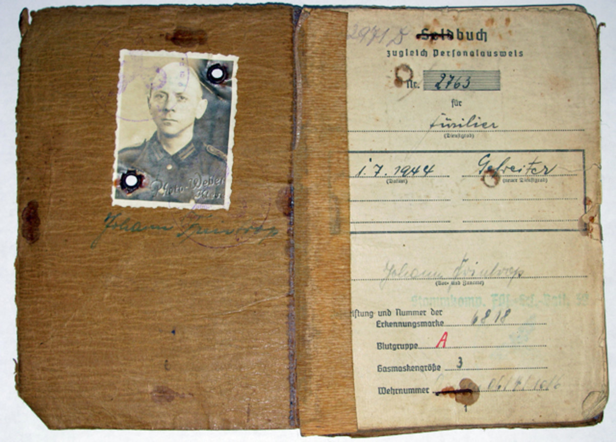 Johann Frintrop's photo inside his well-worn Army Soldbuch reveals a man in his thirties who was called up to serve his country.