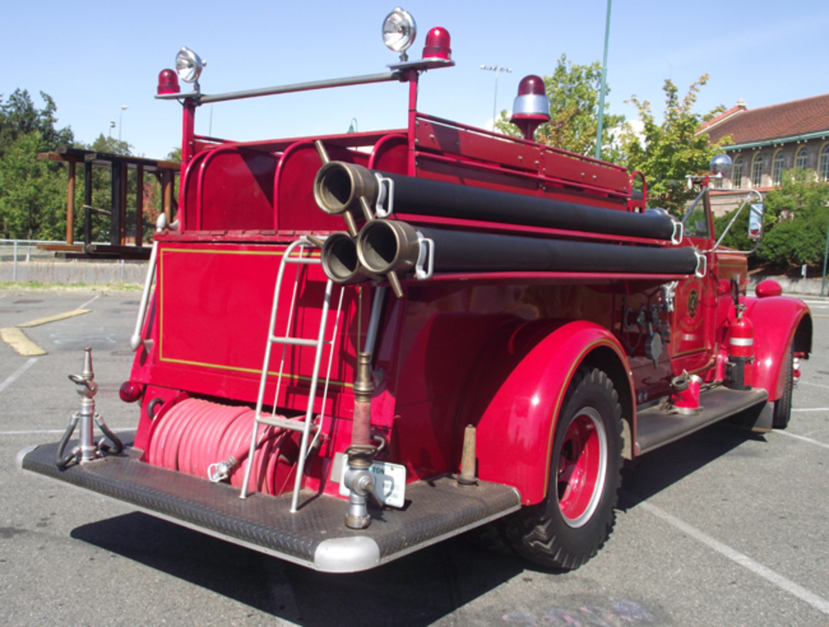 This truck carries three hard-suction hoses rather than the normal two. Body is taller than normal because of the large 500-gallon water tank. The present owner's family and friends enjoy riding in parades on bench seats atop the empty hose bed.