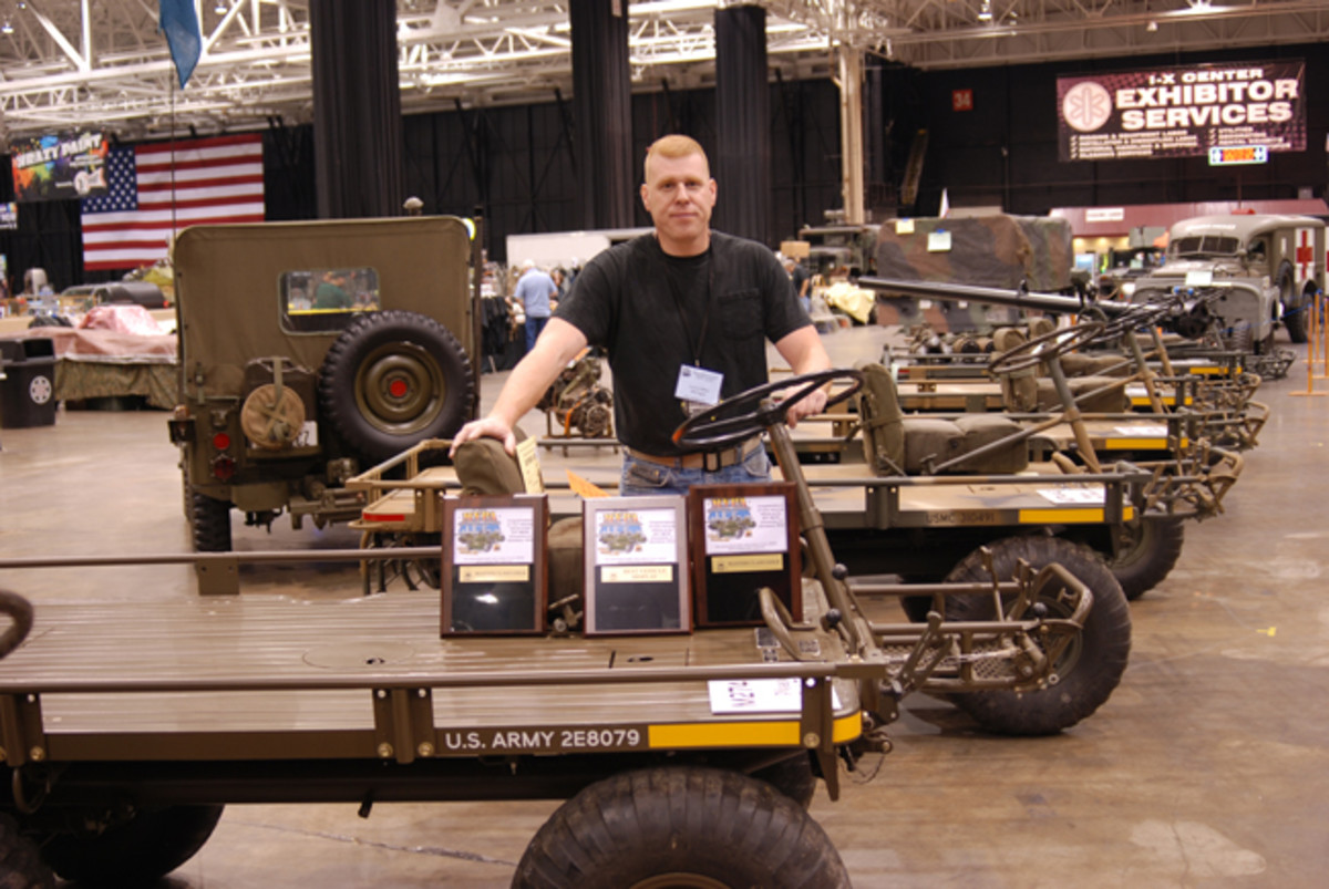 """Lance Miller won the """"Best Vehicle Display"""" for his exhibit of mules that showed each evolution of the 4x4 platform truck."""
