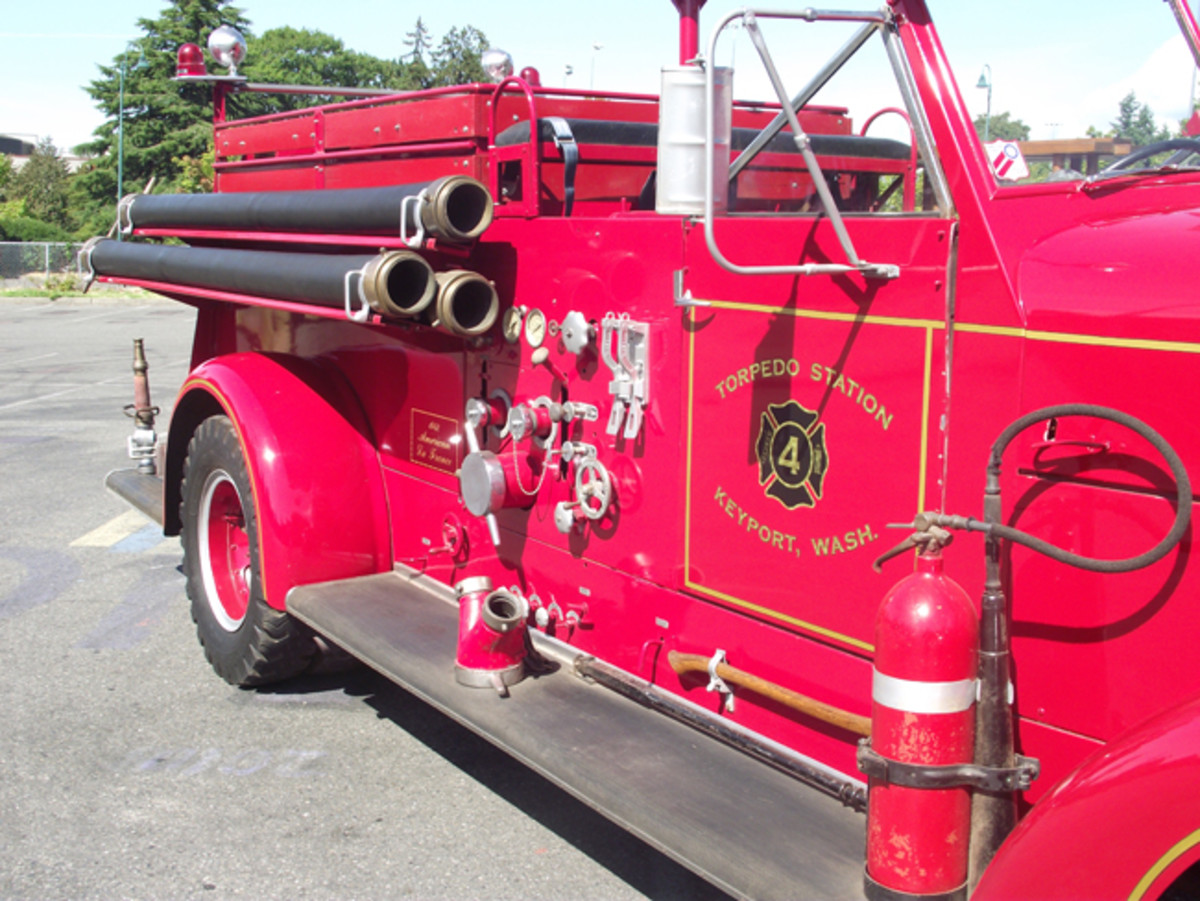 Right side US Navy markings are imaginary, since no photos exist of the original paint job. The pump controls and the suction hoses are on the right side of older American LaFrance pumpers, the opposite of modern rigs. The present owner added the small seat on top for carrying kids.
