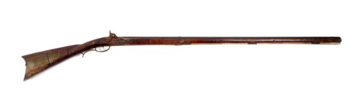 Relief Carved Kentucky Rifle attributed to Leonard Reedy