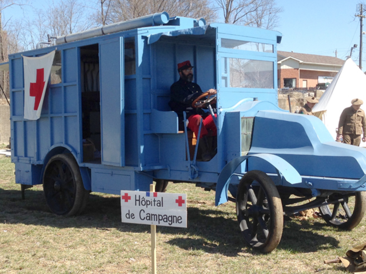 The IMM's rare 1916 Renault Hospital Field Surgery Truck with a reenactor in early war French uniform.