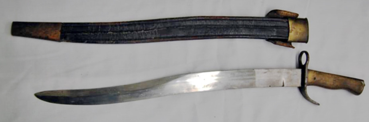 Curved blade bayonet with sheath, marked A19 sold for $2,250.