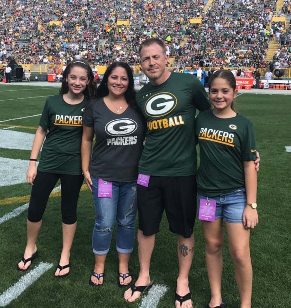 Purple Heart recipient Joshua Krueger is shown with his wife, Jill, and twin daughters, Kylie (left), and Ella (right). (Photo by Michelle Ratchman /Green Bay Packers)
