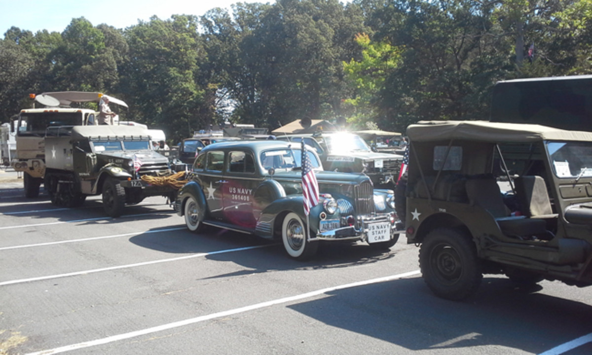 Line up in VA of an M38, 1941 Packard staff car, M2 halftrack, and more.