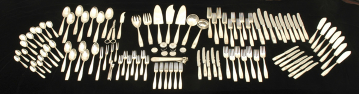 Group picture of massive haul of formal Adolf Hitler silverware taken from the Berghof by a 101st veteran in May of 1945.