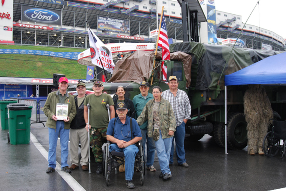 "The whole crew who served as military vehicle ""ambassadors"" (left to right): David Cadorette, Nick Ockwig, Hank Gottz, William J. Waltman, , Donna Gotz, Edd Wagner, Donna Gotz, Terry Waltman and Kenneth Renner."