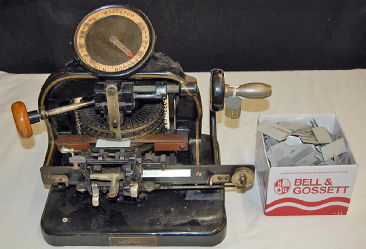 c. 1909 Graphotype dog tag machine model G sold for $300.