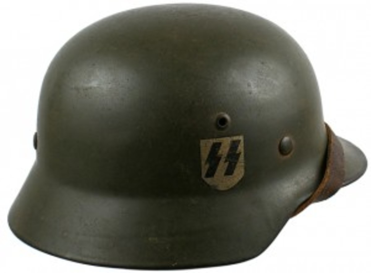 German WWII SS M1935 double decal helmet, with SS and swastika shield, 1938 ($6,413).