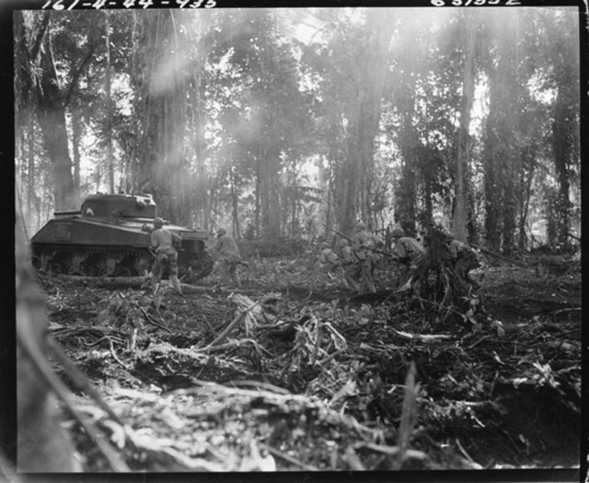 A 2nd Platoon tank of the 754th Tank Battalion with foot soldiers of men of the 143rd Infantry Regiment, photographed on Bougainville in March 1944.