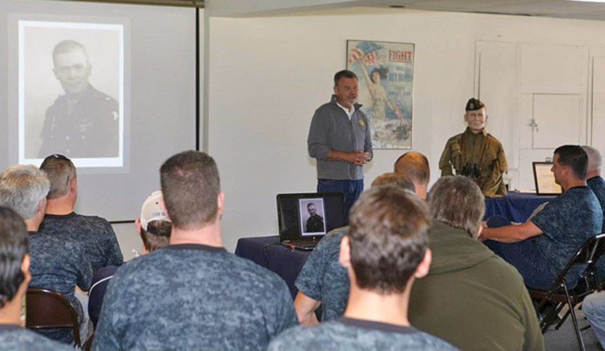 Bill Shea of The Ruptured Duck making a presentation to a group of young executives at the Collings Foundation in Stow, MA. His talk was centered around leadership. Major Dick Winters from E Company, 506 Parachute Infantry Regiment is being discussed.