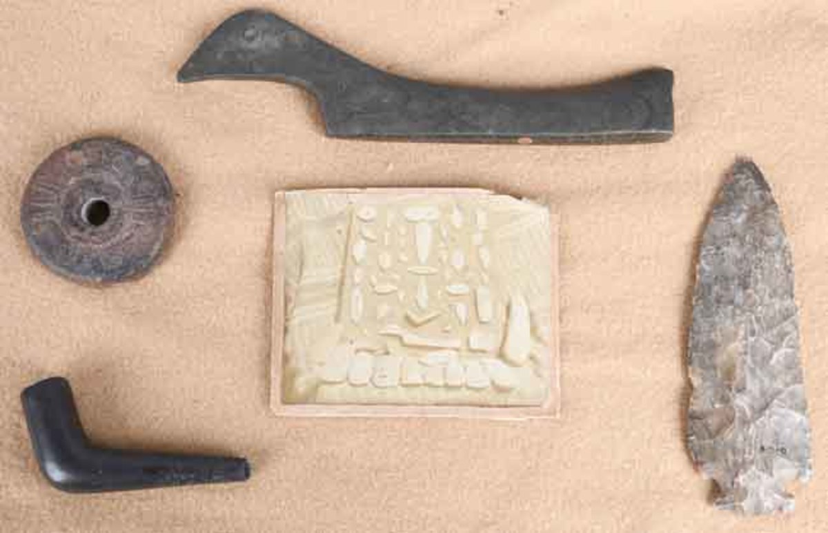 Grouping of Native American artifacts dug in Lake County, Ohio, in the 1890s with impeccable provenance from the digger's family. Includes large 8½-inch pop-eyed birdstone. Sold for $18,600