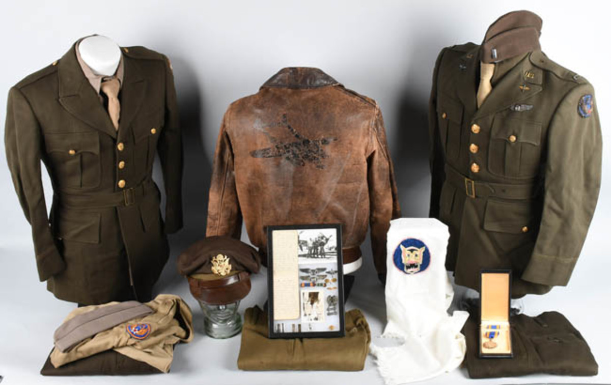 Extensive archive of uniforms, jackets, accessories, medals and career memorabilia of World War II Army Air Force P-39 pilot Joseph Scherer of Cleveland, Ohio. Sold for $12,000 against an estimate of $3,000-$4,000