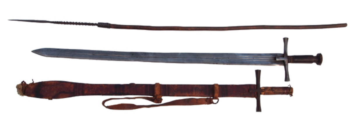 """Two Kaskara swords – a type used in the Sudan, Chad and Eritrea from the 14th century to the late 19th century – and a spear that was also typical to the region. While these swords and spears are associated with the Sudan and were carried by the army of the Mahdi in the late 19th century it is impossible to know if these are truly of """"Sudanese"""" origin or not. What is known and established is that the swords have been in the author's collection prior to the OFAC sanctions against Sudan."""
